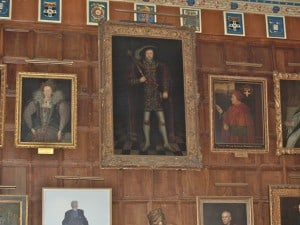 A huge painting of a huge king - Henry VIII - presides over the Great Hall,  flanked by portraits of scholars & other monarchs