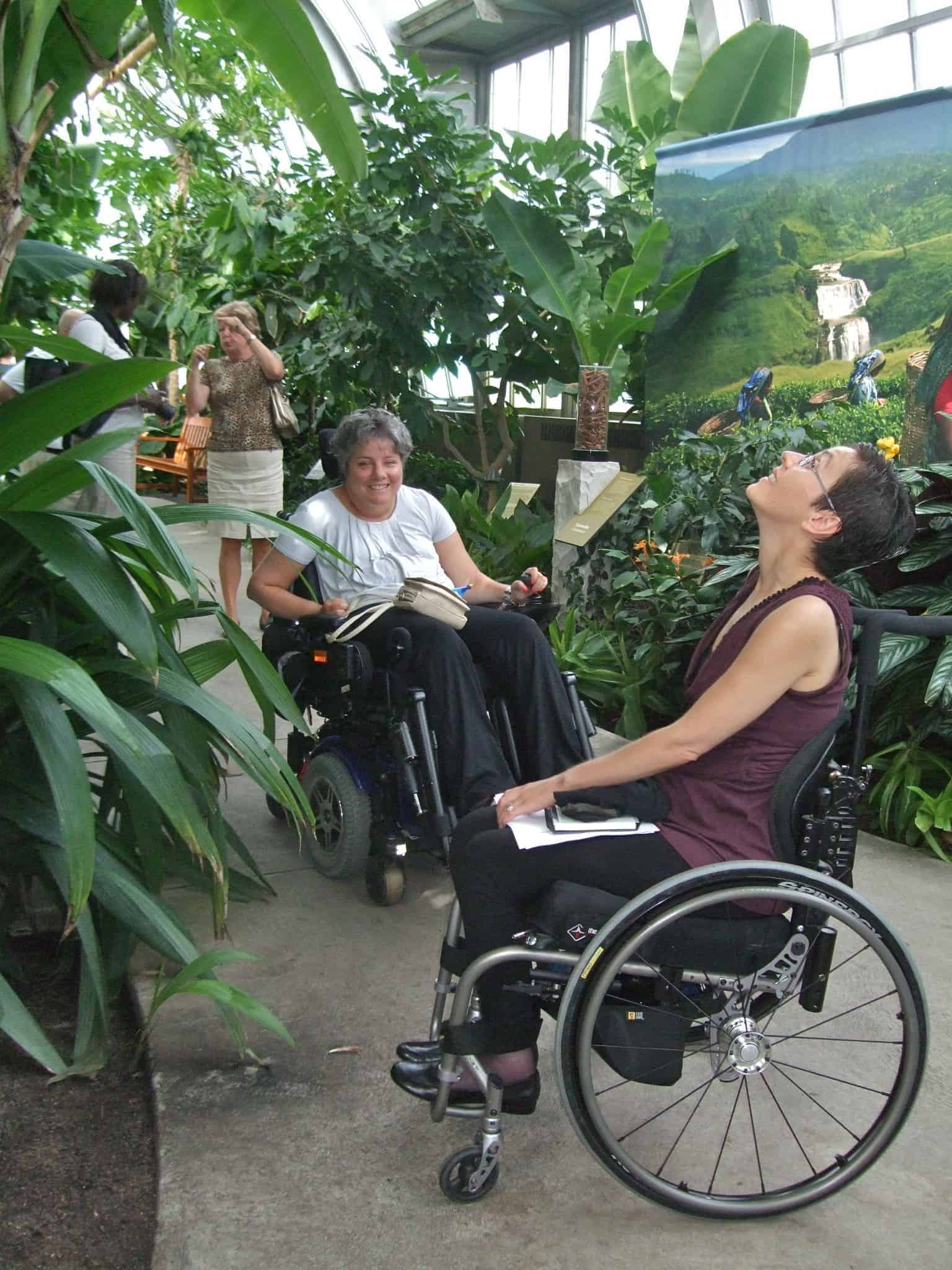 Wide smooth pathways lead wheelchair travellers through Montreal Botanical Gardens' lush tropical greenhouses.
