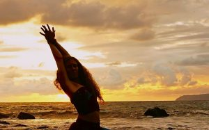 Marla Meenakshi Joy doing yoga on the beach at Pavones Costa Rica