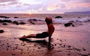 Ron Reid doing yoga on the beach Pavones Costa Rica